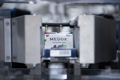 Medox-eske i pakkemaskinen